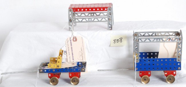 810: Group of Erector wagons and table movie props
