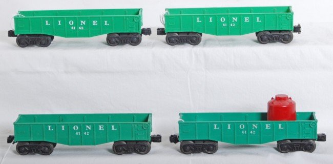 10: Four Lionel 6142 canister/gondola cars