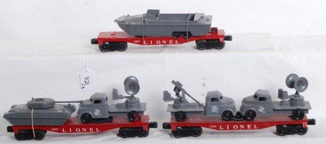 821: Lionel 6803, 6804, 6807 flatcars w/military loads