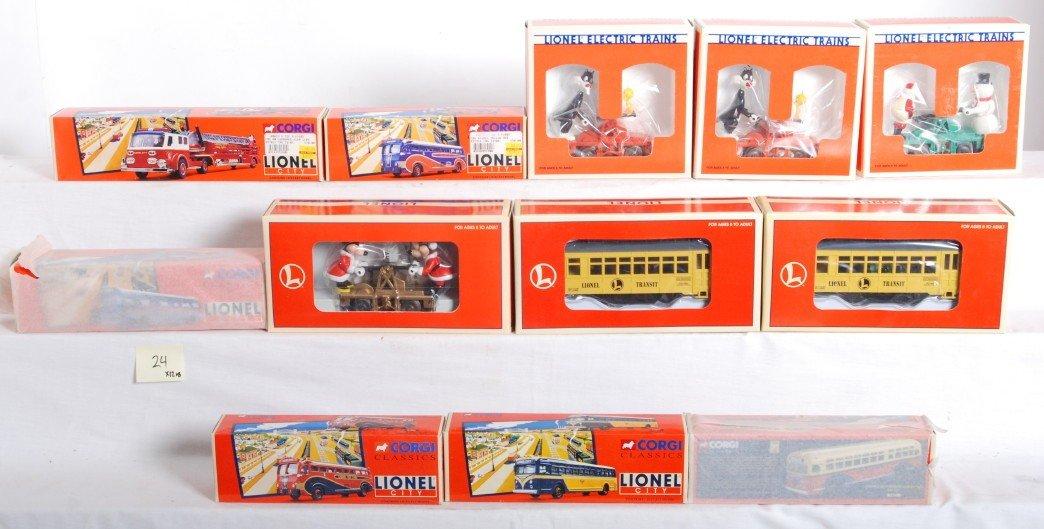 24: 6 Lionel motorized units and 6 Corgi busses