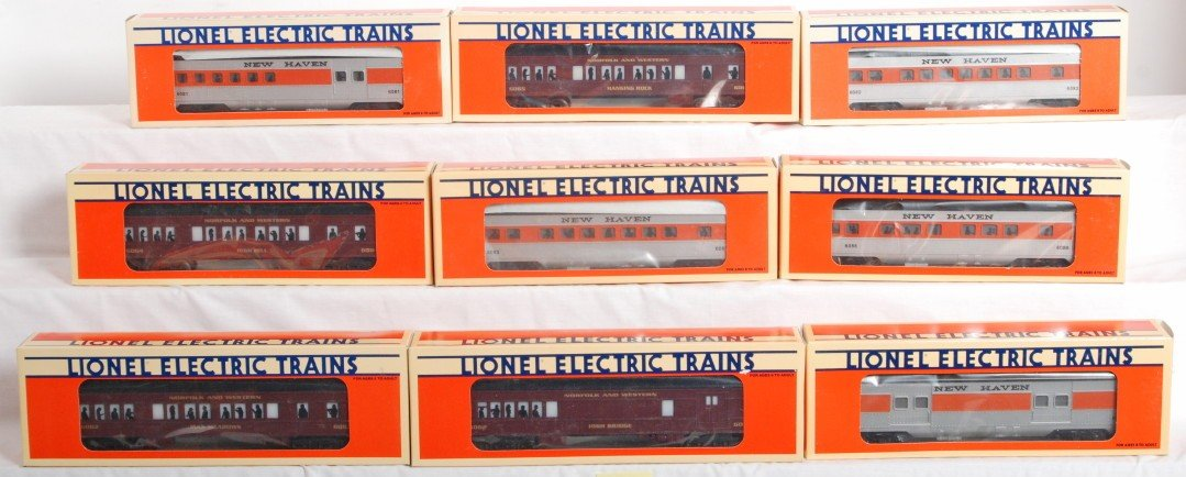 10: 9 Lionel N&W and New Haven pass cars 16062, 16086
