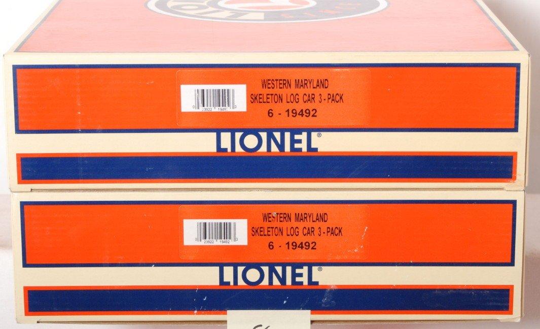 8: 2 Lionel Western Maryland skeleton log car 3 pack