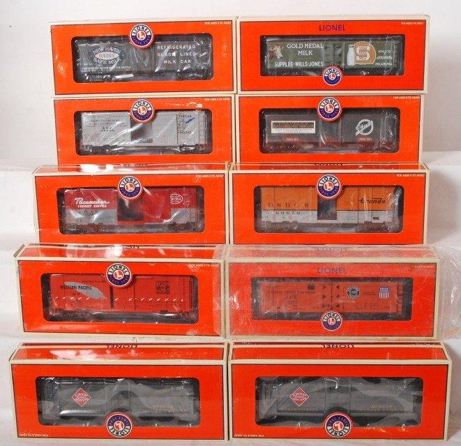 9: 10 Lionel milk and boxcars, 17276, 17275, 17335, etc
