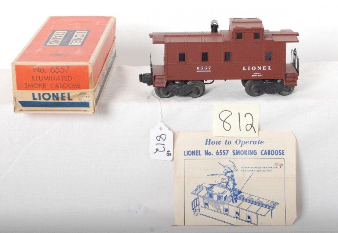 812: Lionel No. 6557 illuminated smoke caboose in OB