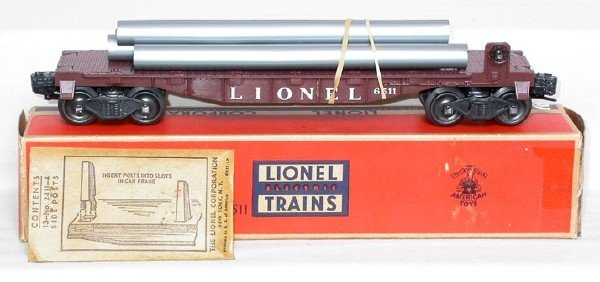 611: Lionel 6511 brown flatcar with pipes, OB