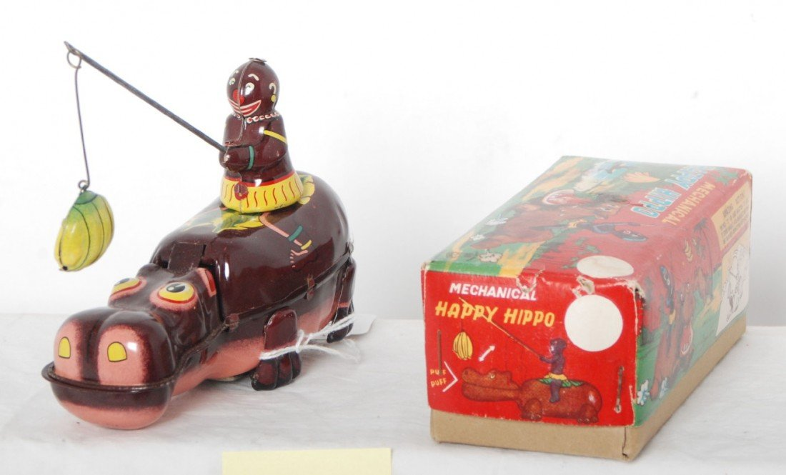 813: Mechanical Happy Hippo tinplate toy w/Native in OB
