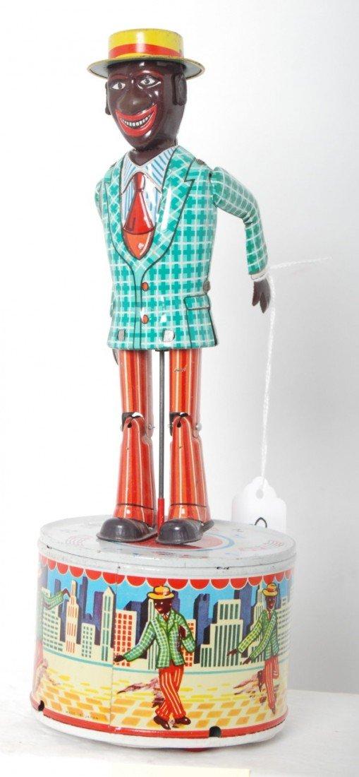 817: Tinplate mechanical windup dancing coon jigger toy