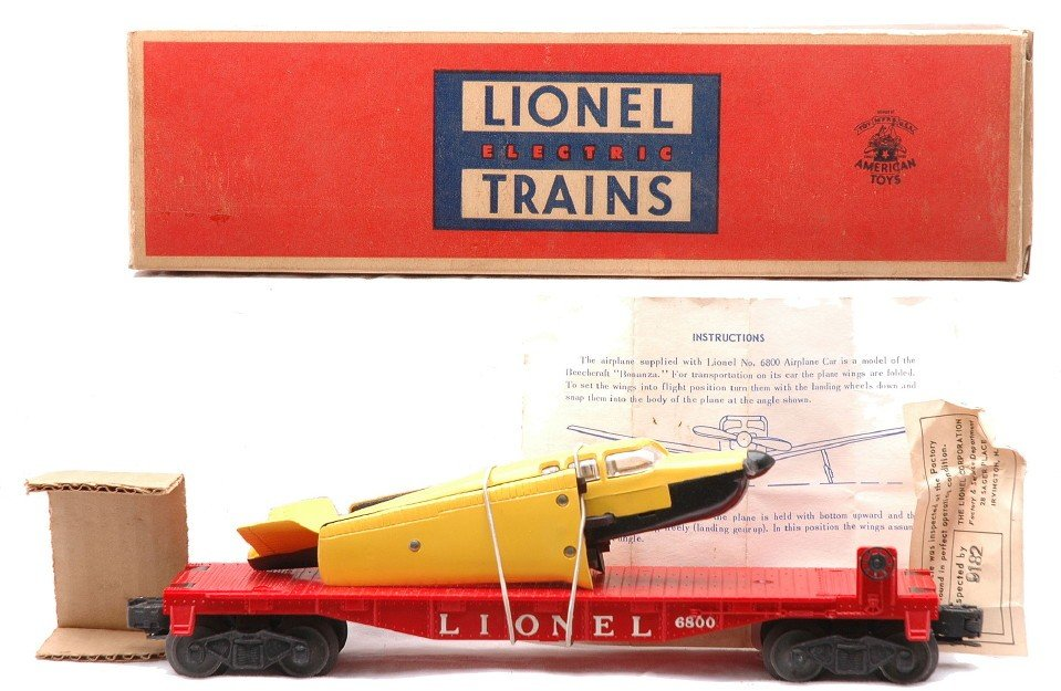 5: Lionel 6800 Flatcar w/Airplane Yellow Wings MIB