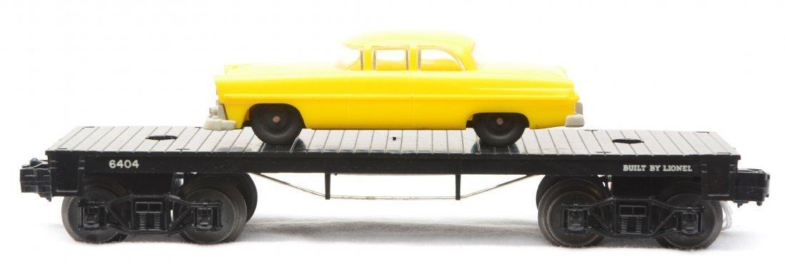 13: Lionel 6404 Flatcar w/Gray Bumper Yellow Car