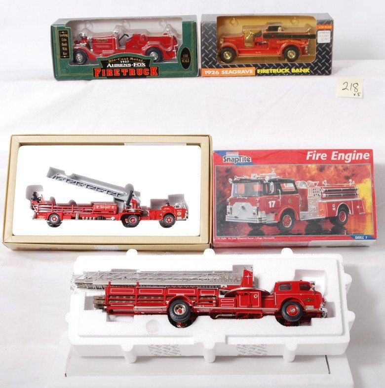 218: Four die-cast Firetruck vehicles and a model truck