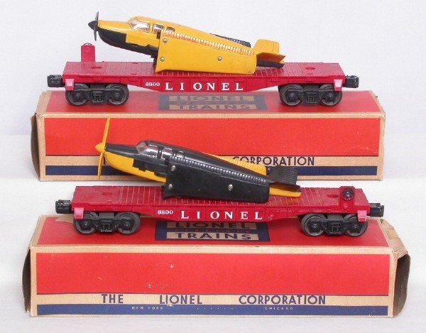 3020: Two Lionel 6800 flatcars w/ planes two variations