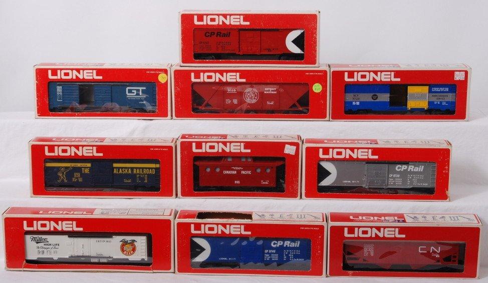 23: 10 Lionel freight cars 9764, 9119, 9703, 9013, etc