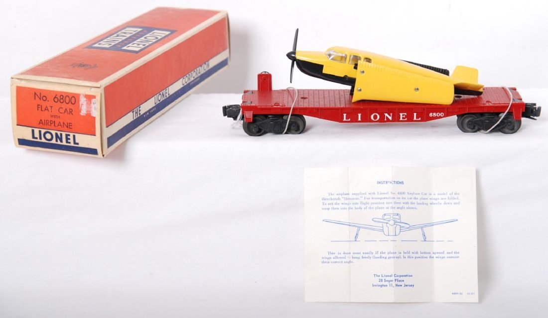 822: Lionel 6800 flat w/yellow over black airplane in O