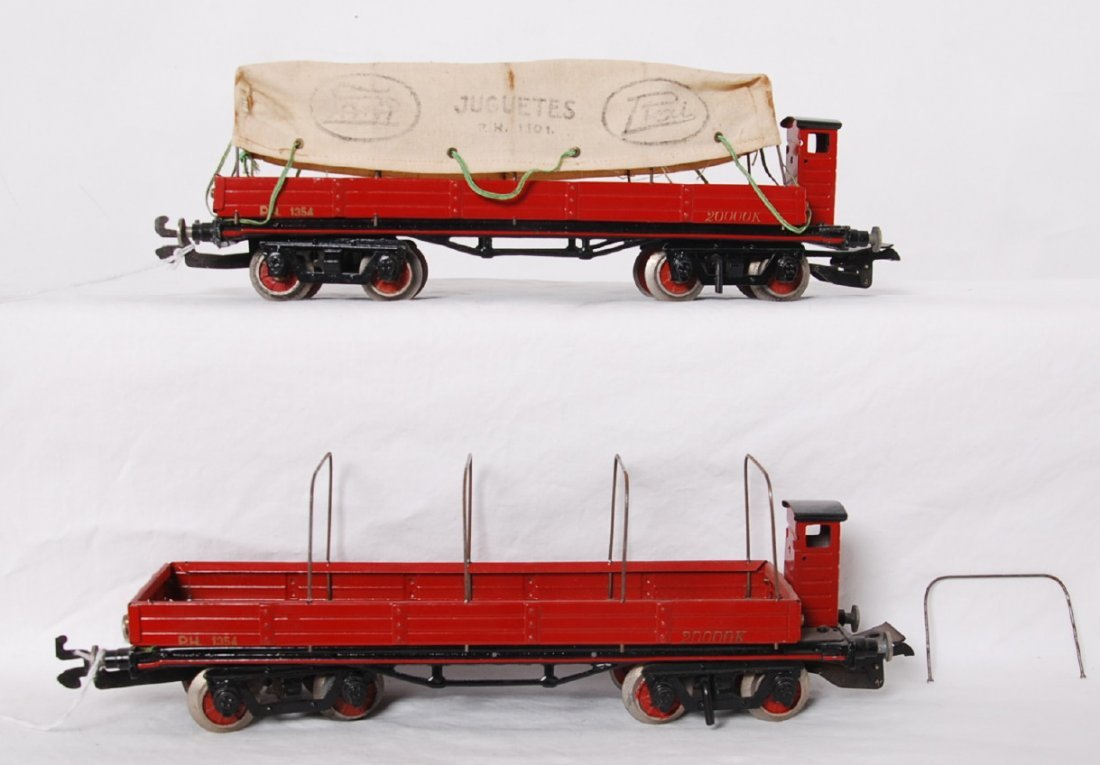 Paya freight cars with dog houses and tarp covering