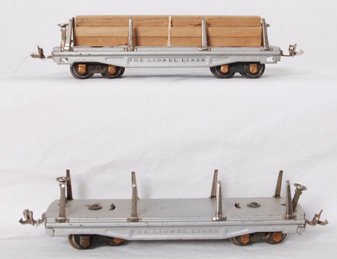Two Lionel 811 flatcars in aluminum with latch couplers