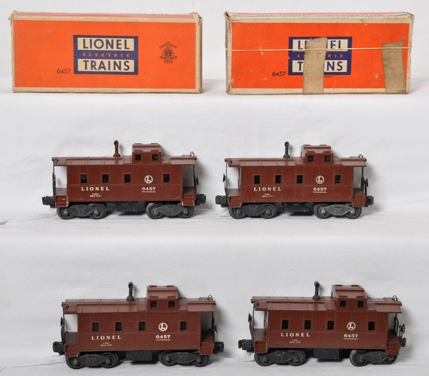 Four Lionel 6457 cabooses with two boxes