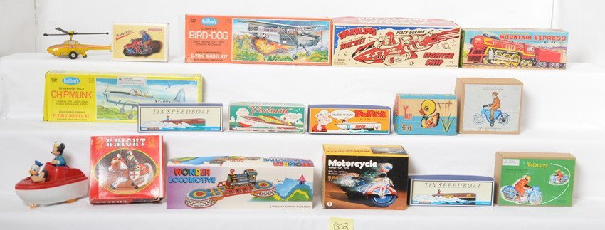 Large lot of lithographed windup tinplate toys in OB...