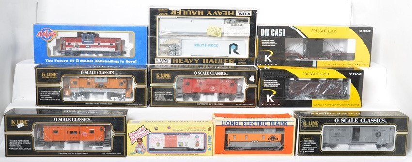 11 K Line, Atlas O and Lionel cabooses and freight cars