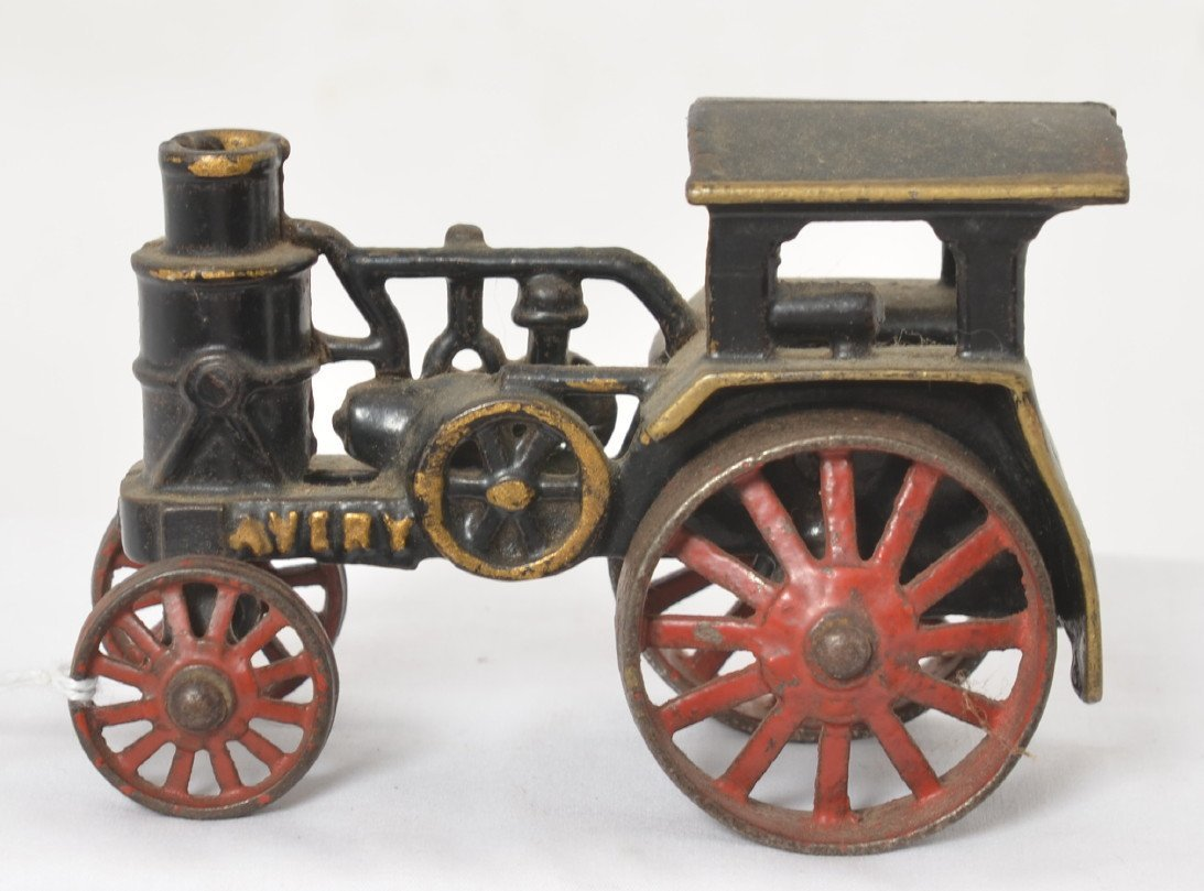Early cast  iron Avery steam powered tractor