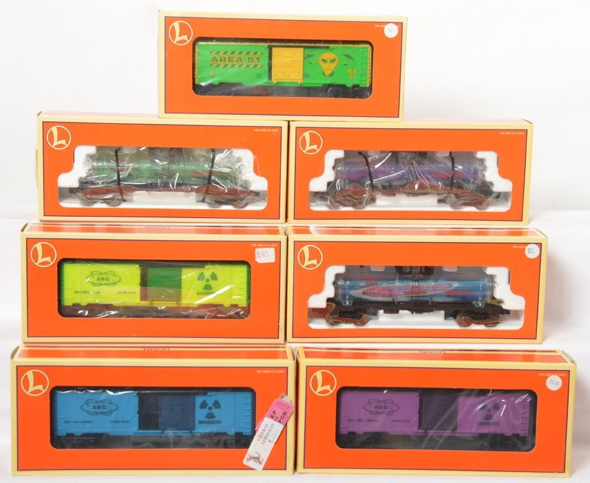 7 Lionel AEC reactor fluid tank cars and boxcars