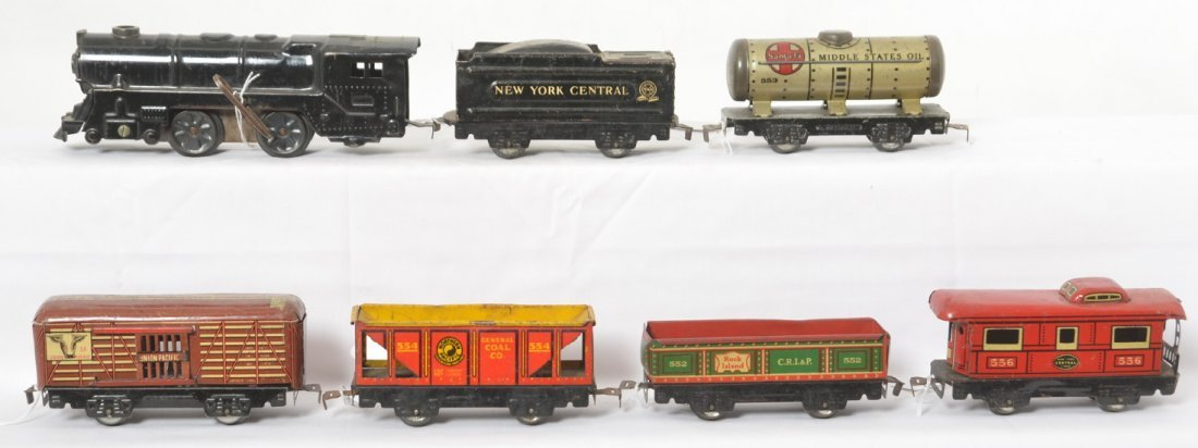Marx windup, NYC tender and five four wheel freight
