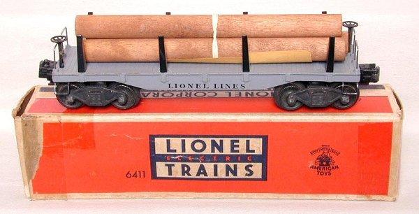 614: Lionel 6411 flat w/ logs, mint, OB
