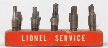 Original Lionel Service Station rivets & wooden holder