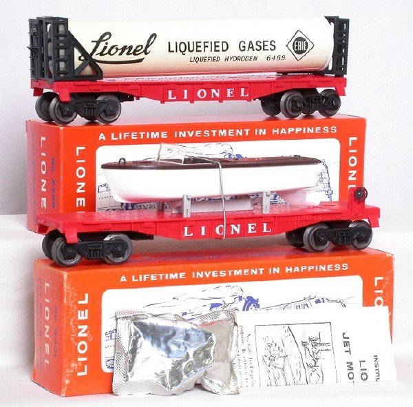 714: Mint Lionel 6501 jet boat and 6469 flat in boxes