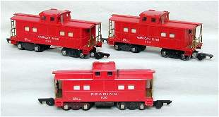 Three Versions of American Flyer 630 cabooses