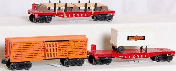 7: Lionel 6646 stock, 6810 flat and a 6264 lumber