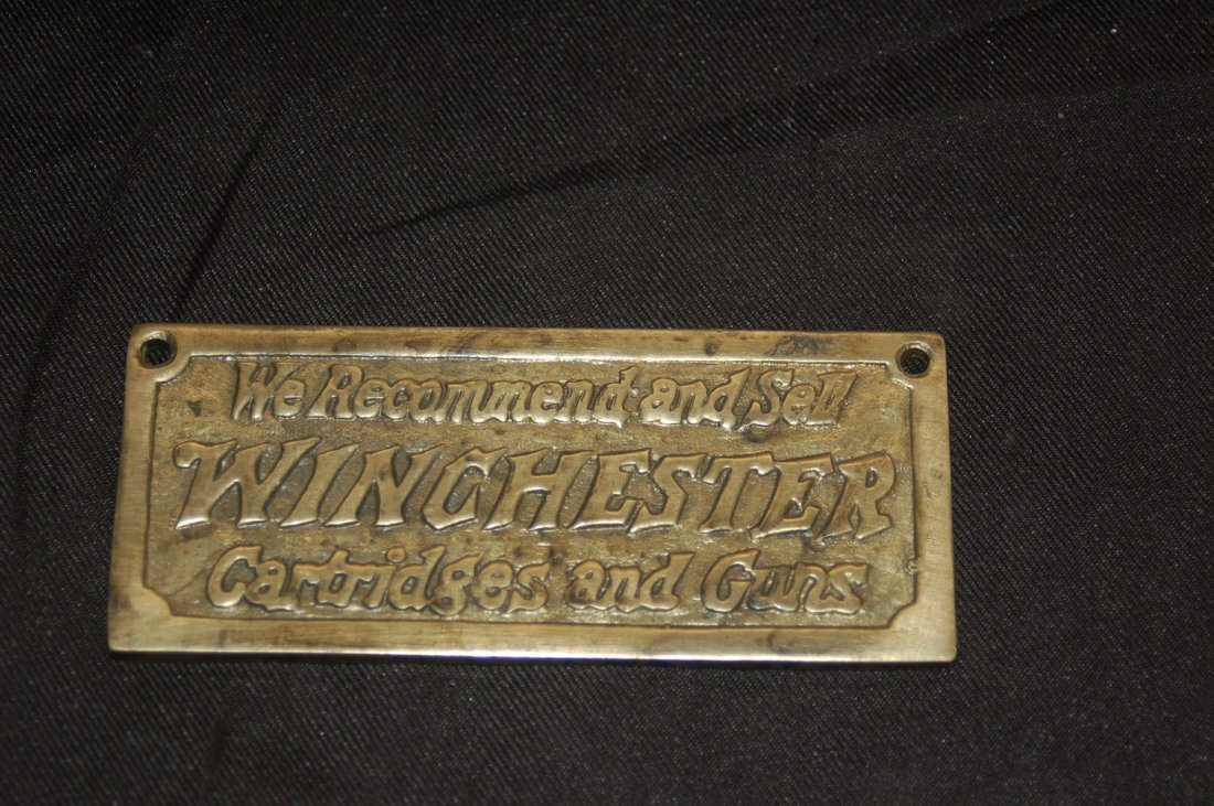 ANTIQUE BRASS WINCHESTER SIGN 2 X 4 IN