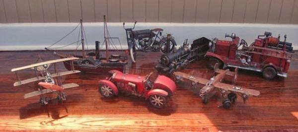 Seven Transportation Tin Décor Items