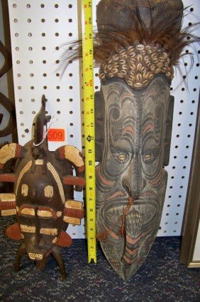 509: 2 ASSORTED TRIBAL WOODEN MASKS