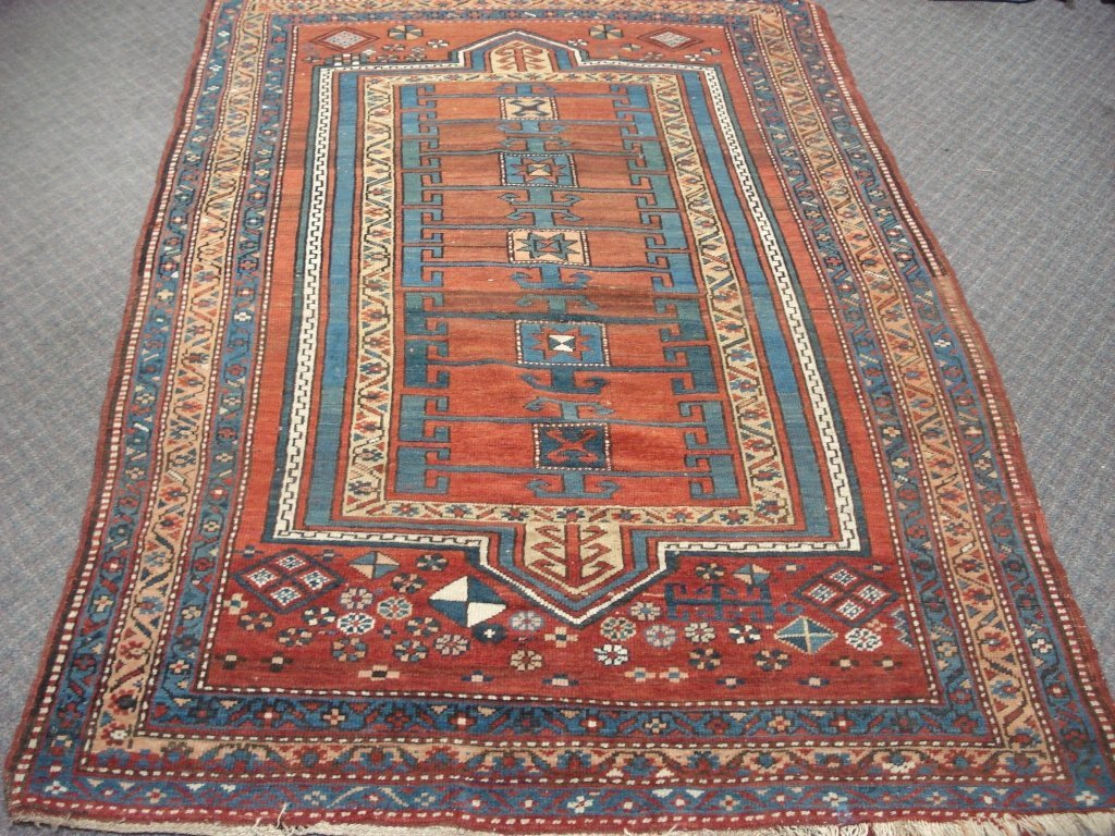 1016: Semi-antique Rug with Rusts, Blues, Tans