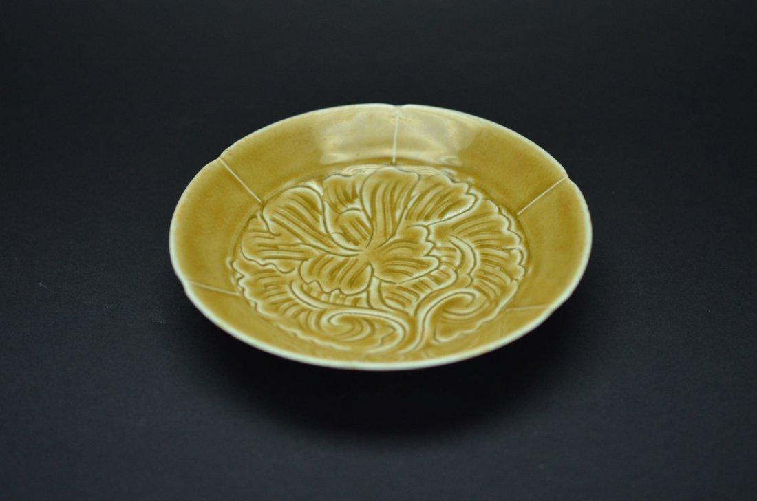 Yellow glaze saucer