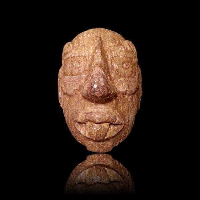 Important Maya Fossilized Bone god G Mask