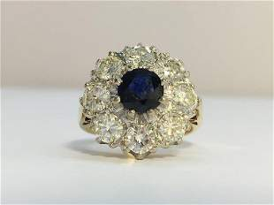 A Vintage Sapphire and Diamond cluster ring in 18ct