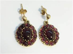 A Pair of Carbuncle Garnet earrings in 9ct yellow gold