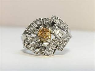 A Vintage Yellow Diamond Cluster Ring set centrally