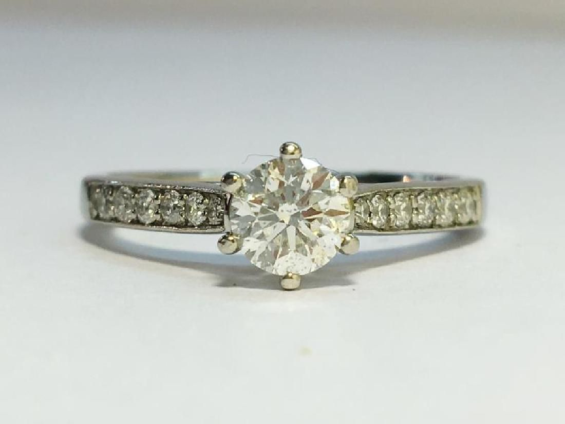 A Contemporary Solitaire Diamond Ring with Platinum