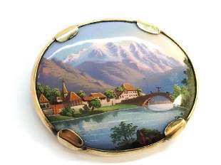 A Continental oval enamelled brooch set in 9ct yellow