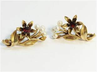A pair of 1950s garnet and pearl earrings fashioned