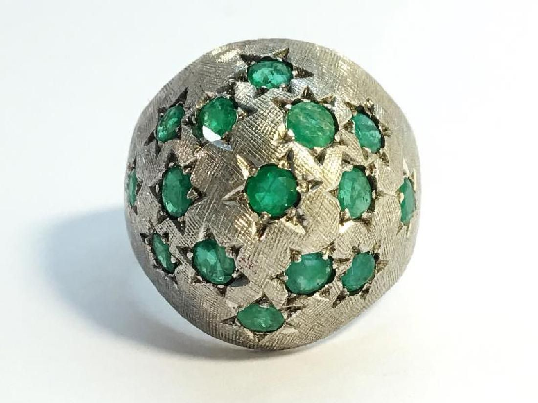 A 1970s emerald bombe ring in 18ct white gold. Set with