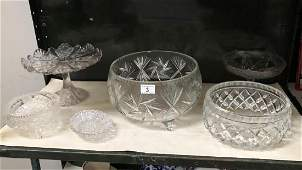 A large cut glass bowl, 3 other bowls and 2 cake