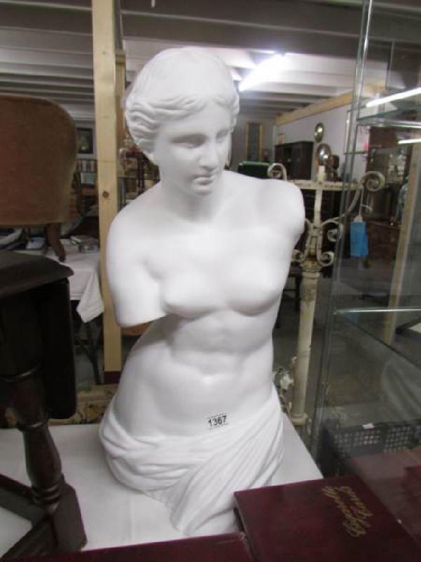 A Venus de Milo figure.