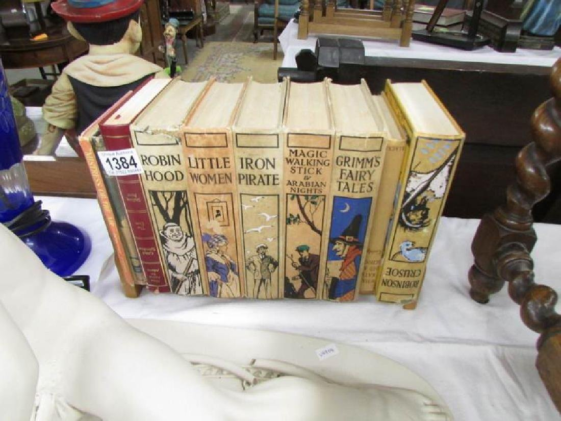 A book stand and books including Robinson Cruseo, Robin