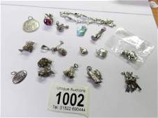 14 silver charms, a St. Christopher pendant and a