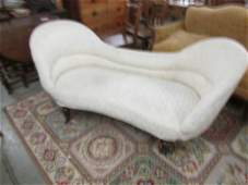 A cream double ended chaise longue.