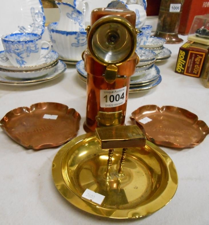 A copper miner's lamp, 2 Worthington copper ashtrays an