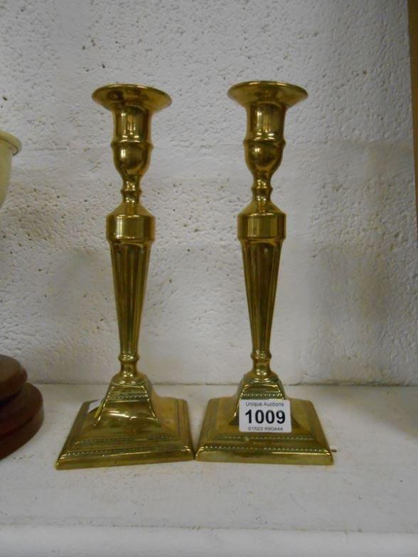 A pair of brass candlesticks, 26cm tall